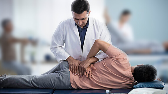 Undergoing regular physiotherapy for extreme episodes of back pain